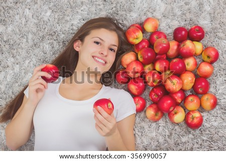 Happy Beautiful Young Woman, with group healthy organic red apples, brunette female at home - stock photo