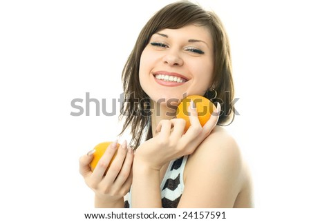 happy beautiful young woman with oranges in her hands - stock photo