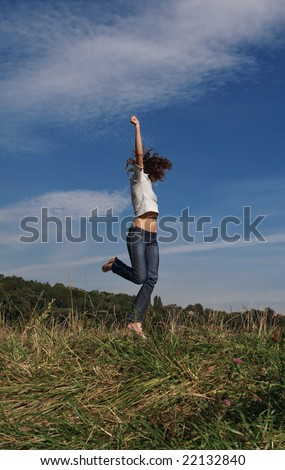 Happy beauty young woman jump - stock photo