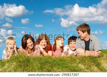 Happy big family outdoors               - stock photo