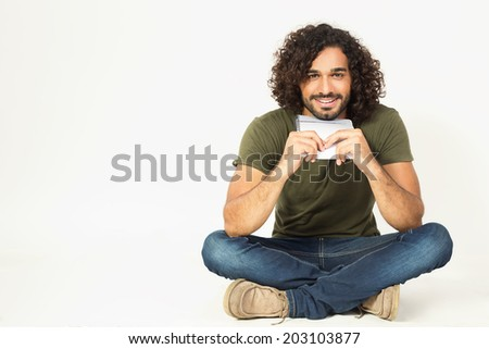 happy biracial student holding a book in his hands - stock photo