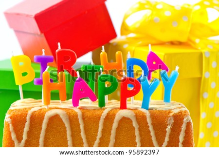 happy birthday. birthday cake with letter candles and gifts. card concept - stock photo
