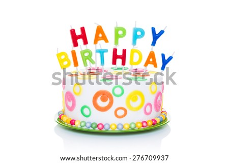 happy birthday cake or tart with happy birthday letters as candles very colourful and looking very tasty, isolated on white background - stock photo
