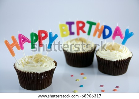 Happy Birthday candles in cup cakes - stock photo
