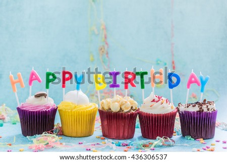 happy birthday celebration cupkace candles, copy space bacground above - stock photo