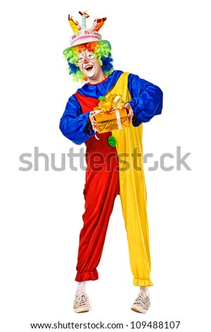 Happy birthday clown with a gift box. Full body isolated - stock photo