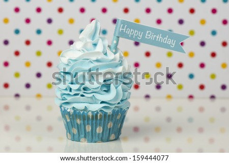 Happy Birthday cupcake on dotted background - stock photo