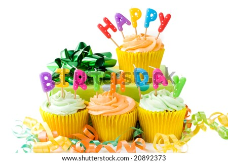 Happy Birthday cupcakes with gift - stock photo