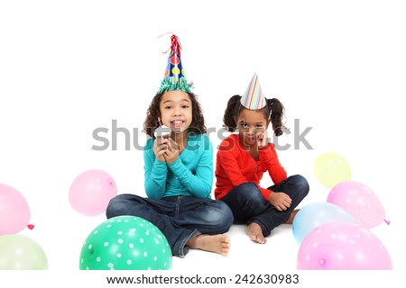 Happy Birthday girl with a jealous sister - stock photo