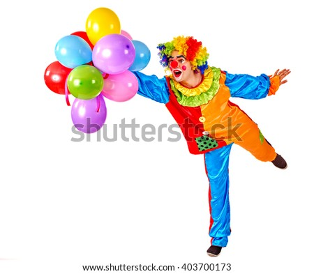 Happy birthday. Glad clown holding a bunch of balloons.  Isolated. - stock photo