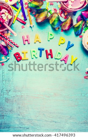 Happy birthday greeting card with party tools ,drinks and  confetti on turquoise shabby chic background, top view place for text, border, vertical - stock photo
