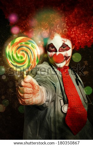 Happy birthday party clown giving out colorful lollies at circus carnival. Entertainment performer - stock photo
