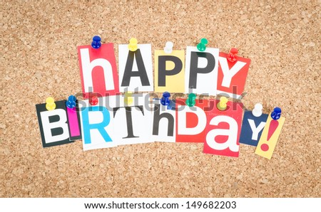 Happy Birthday, pinned on cork bulletin board. - stock photo