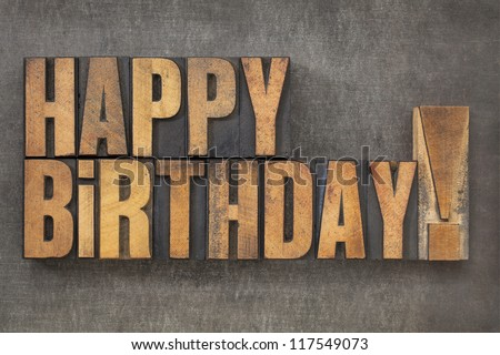 Happy Birthday! -  text in vintage letterpress wood type blocks on a grunge metal background - stock photo