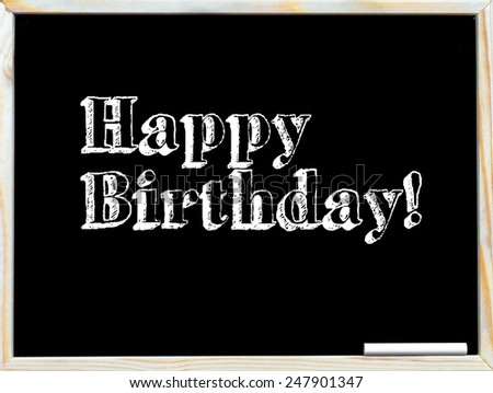 Happy Birthday, vintage chalk text on blackboard, white chalk in the corner - stock photo