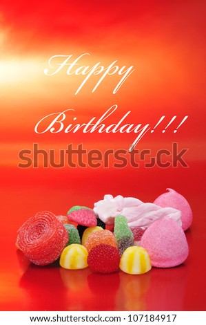 happy birthday written in different colors in a blackboard label - stock photo