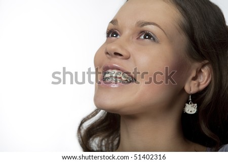 happy bite fixing with modern bracket system for young girl isolated over white background - stock photo