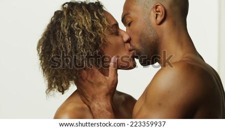 Happy black couple kissing - stock photo