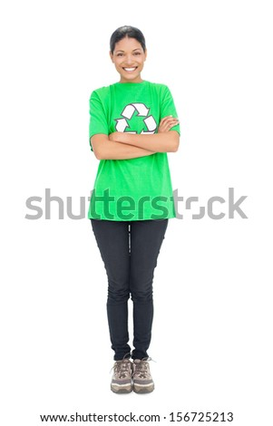 Happy black haired model wearing recycling tshirt on white background - stock photo