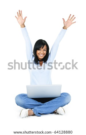 Happy black woman with arms raised and computer isolated on white background - stock photo