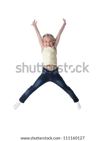 Happy blonde girl in jeans jumping - stock photo