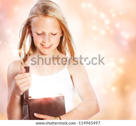 Happy Blonde Girl Opening a Present - stock photo