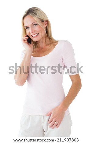 Happy blonde talking on the phone on white background - stock photo
