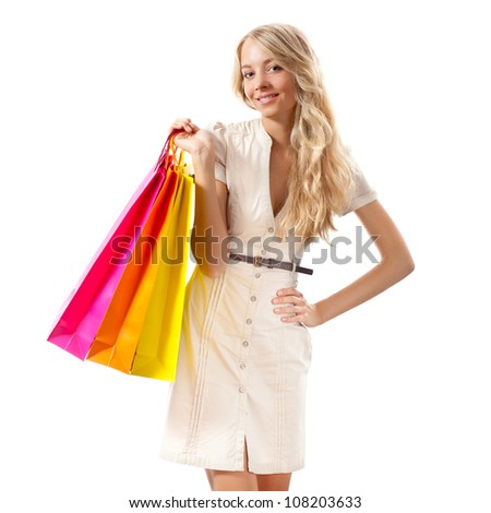 happy blonde woman holding shopping bags over white - stock photo