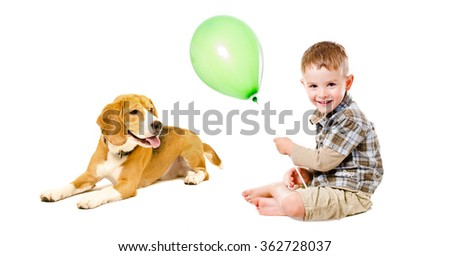 Happy boy and beagle dog sitting together, isolated on a white background - stock photo