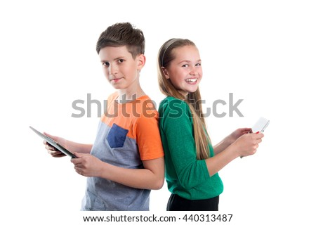 Happy boy and girl are looking at tablet PC's - stock photo