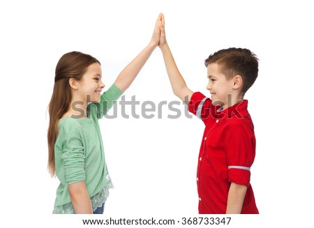 happy boy and girl making high five - stock photo