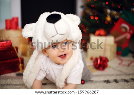 happy boy in a bear hat - stock photo