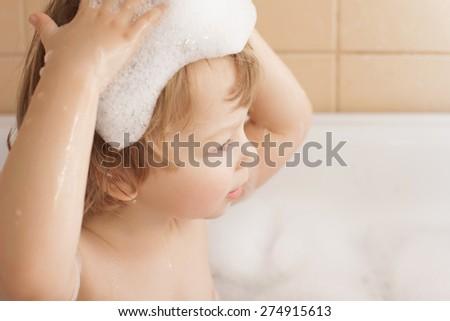 happy boy in bathtub - stock photo