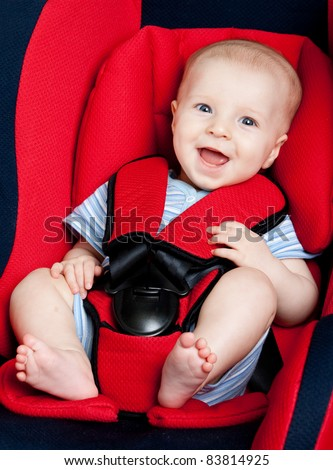 Happy boy in car seat - stock photo