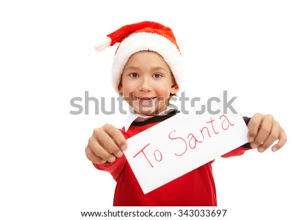 Happy boy in Santa cap showing Christmas letter - stock photo
