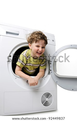 happy boy in the washing machine - stock photo