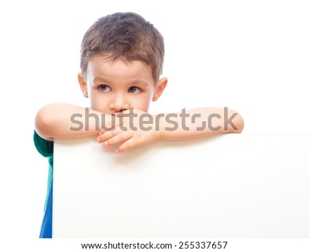 Happy boy is holding blank banner, isolated over white - stock photo