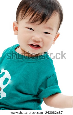 Happy boy looking at the camera with a small smile  - stock photo