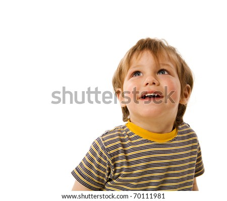 Happy Boy looking up laughing isolated on white - stock photo
