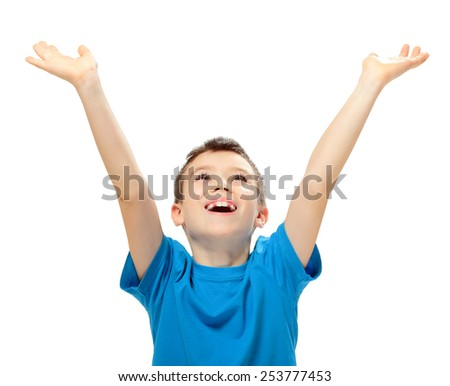 Happy boy looking up with his hands up on white background - stock photo