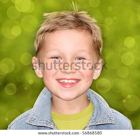 Happy boy on a green background - stock photo
