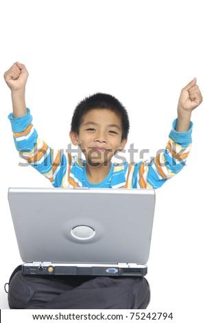 happy boy on laptop - stock photo