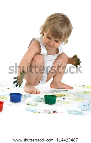 happy boy playing with paint - stock photo