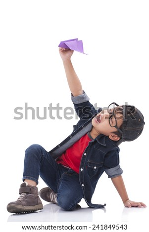 Happy boy playing with paper airplane  - stock photo