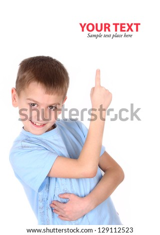Happy boy pointing up isolated on white background - stock photo