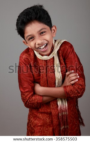 Happy boy wearing traditional Indian dress - stock photo