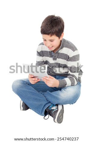 Happy boy with a tablet isolated on a white background - stock photo