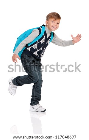 Happy boy with backpack isolated on white background - stock photo