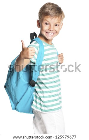 Happy boy with backpack showing thumbs up isolated on white background - stock photo