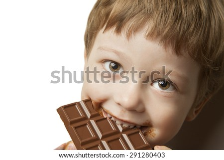 happy boy with chocolate bar - stock photo